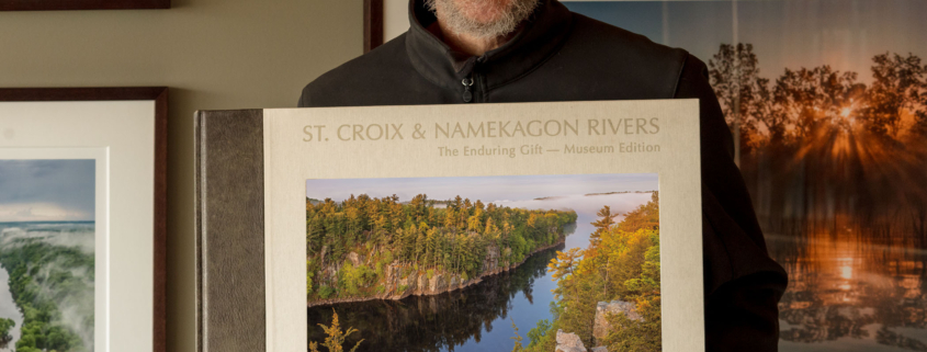 Photographer Craig Blacklock with a copy of his published book