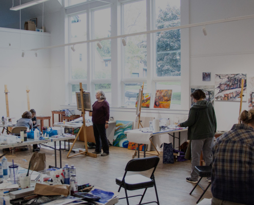 Artists busy at work in the studio at Grand Marais Art Colony